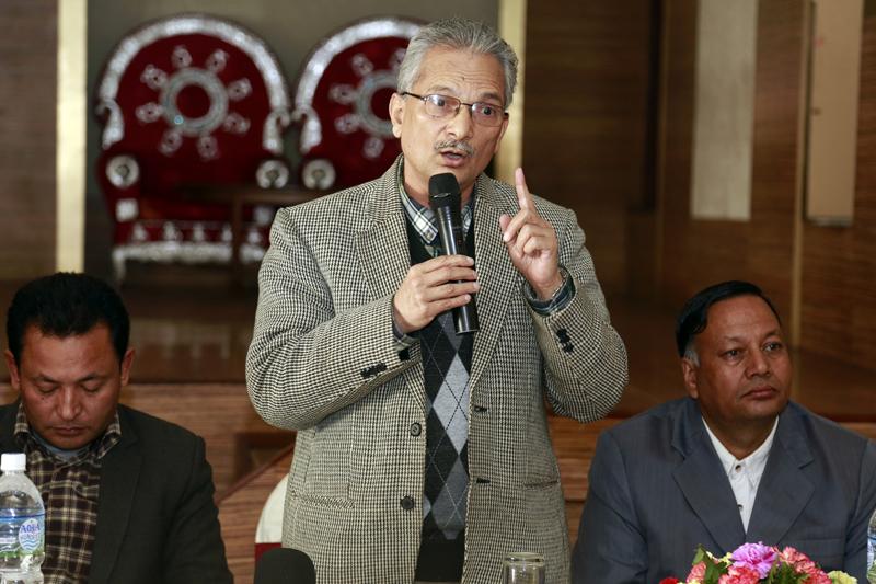 Former Prime Minister Baburam Bhattarai speaking with journalists, in New Baneshwor of Kathmandu, on Saturday, November 21, 2015. Photo: RSS