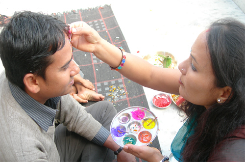 A woman applies seven colours on the forehead of her brother on the auspicious occasion of Bhaitika in Kathmandu on Sunday, November 7, 2010. Photo: Tika R Pradhan/Filen
