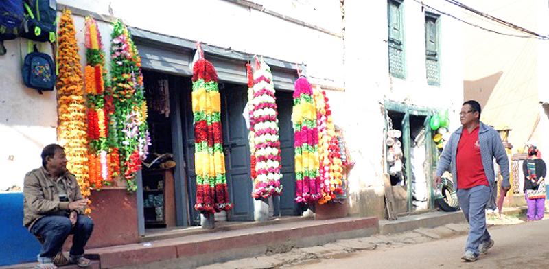 Artifical flower vendor waiting customers at Bhojpur Bazaar in the wake of Tihar Festival. Photo: Niroj Koirala