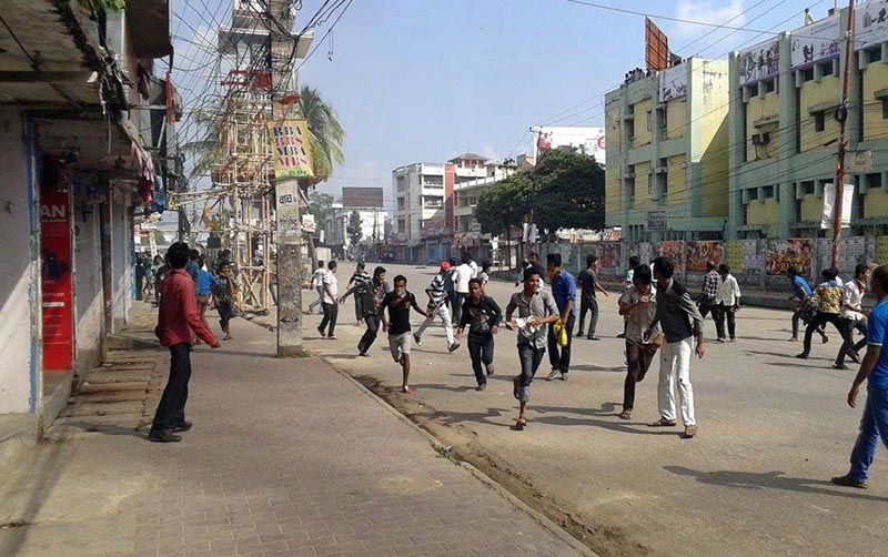 Protesters run away from police as the latter opened fire during a protest in Birgunj of Parsa, on Monday, November 2, 2015. Photo: Ram Sarraf