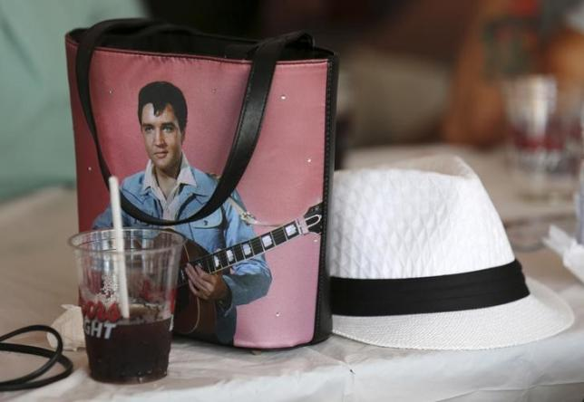 A fan's purse featuring the image of Elvis Presley lies on a bar table during the four-day Collingwood Elvis Festival in Collingwood, Ontario July 25, 2015. Photo: Reuters/ File