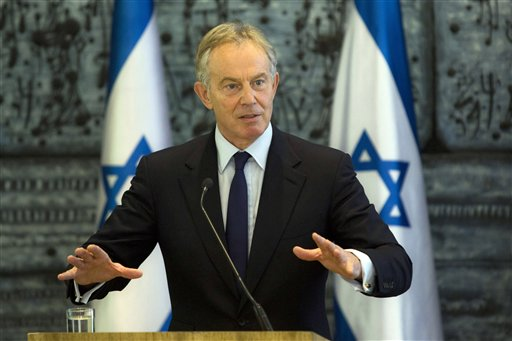 In this Tuesday, July 15, 2014 file photo, former British Prime Minister and Mideast envoy Tony Blair gestures as he speaks during joint statements with Israel's President Shimon Peres at the presidential residence in Jerusalem. Blair said he is ready to jump back into the difficult world of Mideast peace-making. Photo: AP/ File