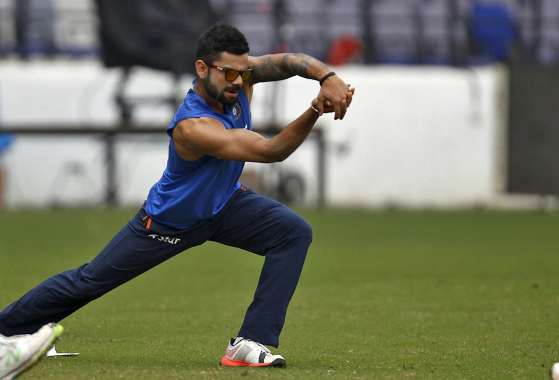India skipper Virat Kohli stretches during a team training session in Nagpur on Tuesday. Photo: Reuters