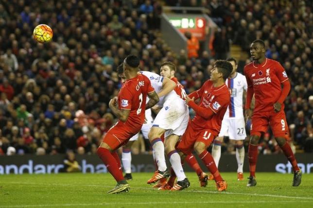 Crystal Palace's Scott Dann (C) scores their second goal. Action Images via Reuters