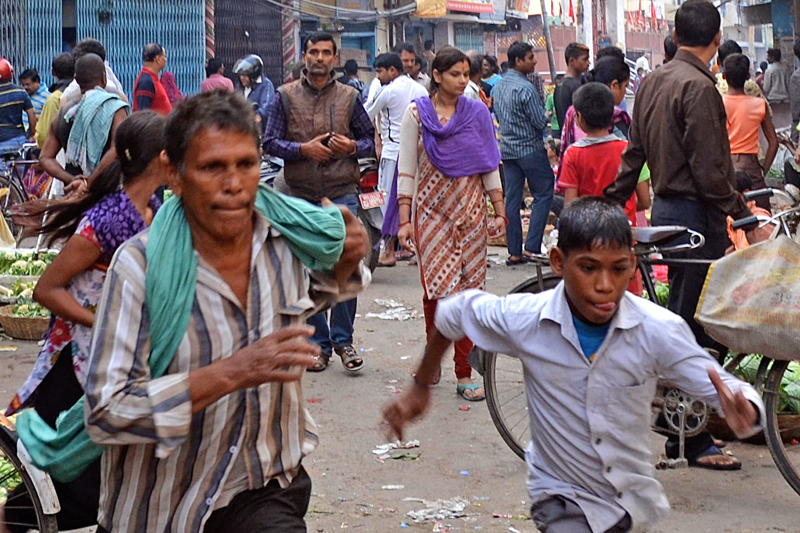 The locals running in various directions after security personnel fired bullets in the air in Maisthan Temple of Birgunj on Tuesday, November 03, 2015. Photo: Ram Sarraf