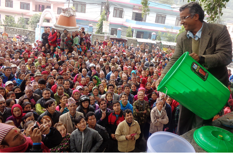 Consumers wait for results of the lucky draw as authorities in Myagdi district headquarters, Beni, choose winners for distribution of cooking gas, on Saturday, November 28, 2015. Photo: RSS