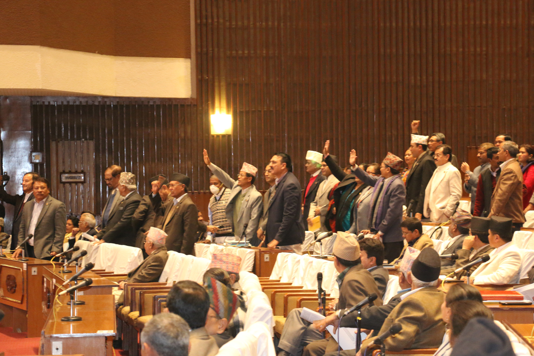 Lawmakers of opposition party Nepali Congress and United Democratic Madhesi Front (UDMF) standing up in their seats seeking permission to speak shortly after the Legislature-Parliament meeting started in Baneshwor, on Thursday, November 26, 2015. Photo: RSS