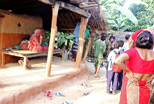 Neighbours gather around the house of Dhan Bahadur Budathoki in Triyuga Muncipality,whose  three month-old baby boy Padam died on the  way to the hospital due to frequent intervention  on the ambulance by the madhesi agitators along the East-West Highway on Monday.