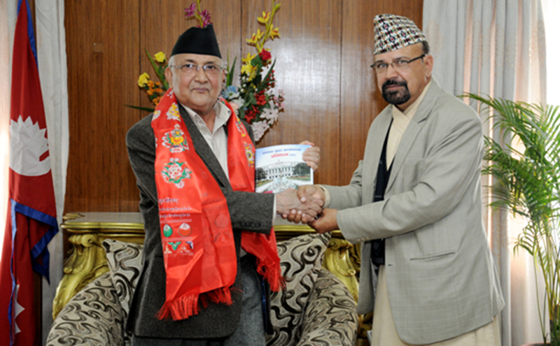 Prime Minister KP Sharma Oli receives the report of High Level Administrative Reforms Monitoring Committee from the Committee Chairman Kashiraj Dahal, in Kathmandu, on Sunday, November 1, 2015. Photo: RSS