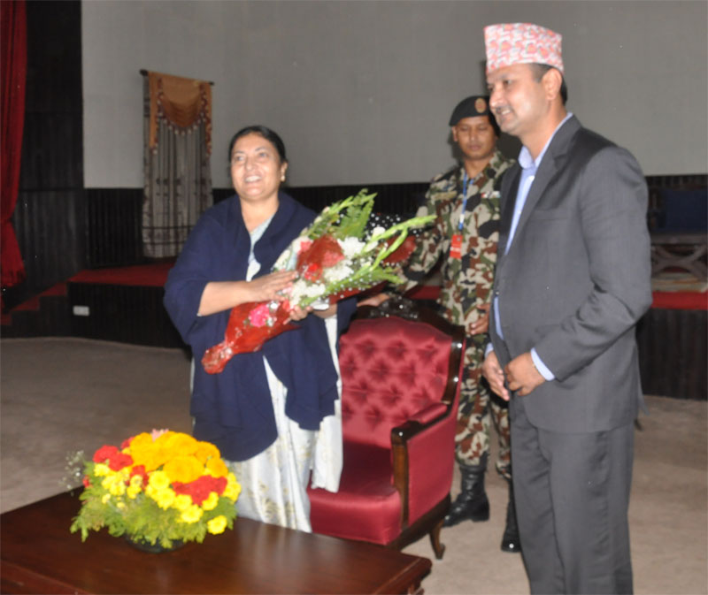 Federation of Nepali Journalists (FNJ) President Mahendra Bista congratulating President Bidya Devi Bhandari at the Sheetal Niwas, on Thursday, November 4, 2015. Photo: FNJ
