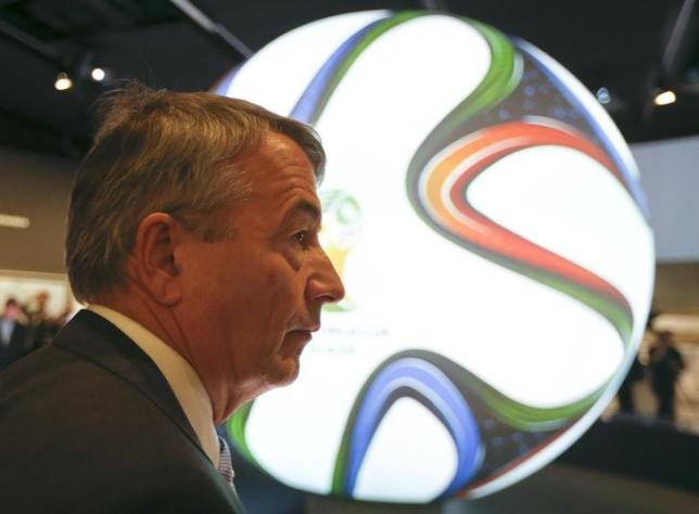 Wolfgang Niersbach, president of the German Football Association (DFB) is silouetted against a huge illuminated World Cup Brazil 2014 soccer ball during the opening of the new German soccer museum in Dortmund October 19, 2015. Photo: REUTERS