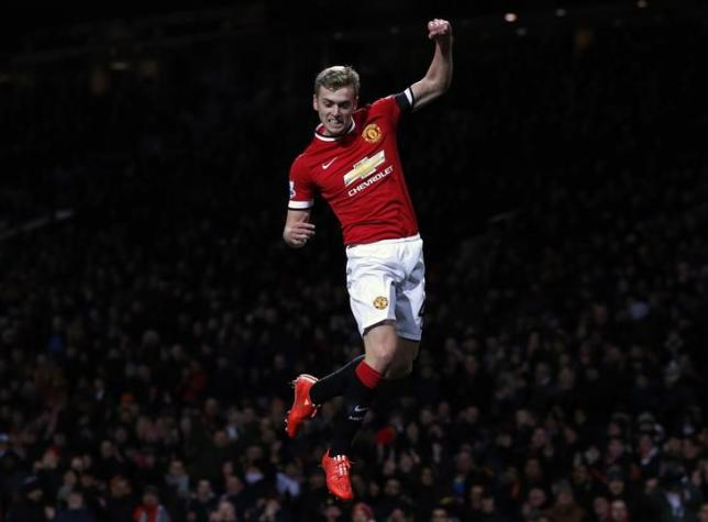 Manchester United's James Wilson celebrates after scoring a goal against Cambridge United during their FA Cup fourth round soccer match at Old Trafford in Manchester, northern England February 3, 2015.  REUTERS/Phil Noble