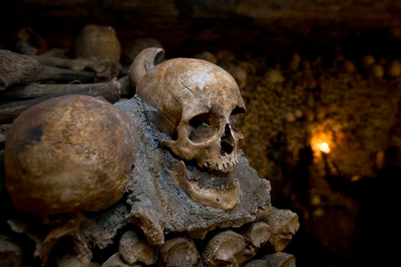 skulls and bones are stacked at the Catacombs in Paris, France on Tuesday, October 14, 2014. Photo: AP