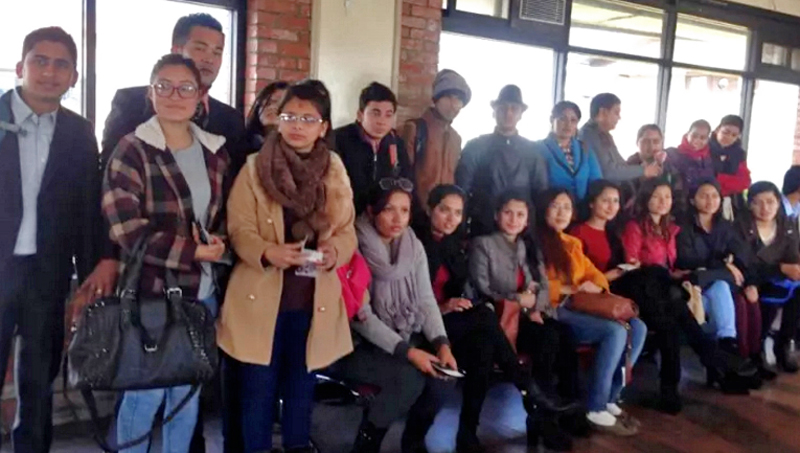 Youths, supposedly quake victims, pose for a photograph at the Tribhuvan International Airport, before they leave for China on a weeklong visit, on Friday, December 11, 2015. Photo: THT
