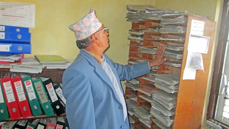 Nepal Electricity Authority Thanahun Distribution Centre looks at the application for new electricity meter in the district on Tuesday, December 15, 2015. Photo: THT