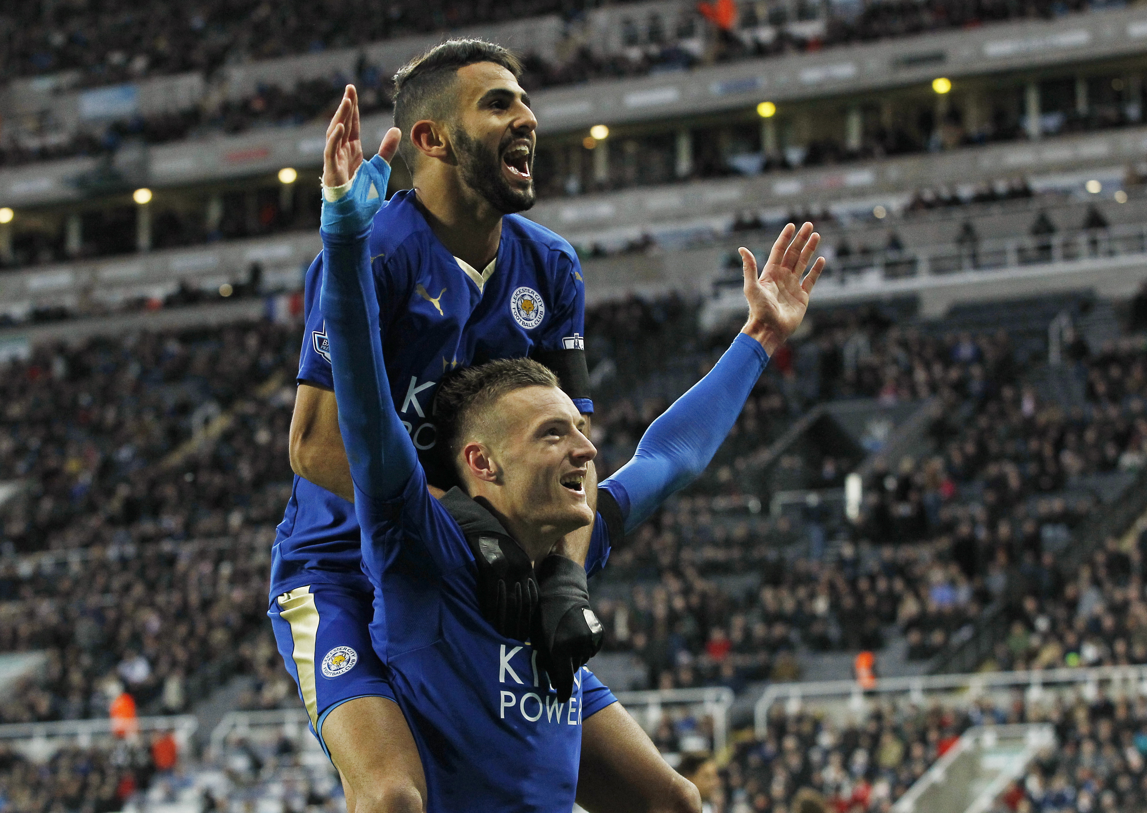 Jamie Vardy celebrates with Riyad Mahrez after scoring the first goal for Leicester City to equal the record for scoring in consecutive Premier League games. Photo: Reuters