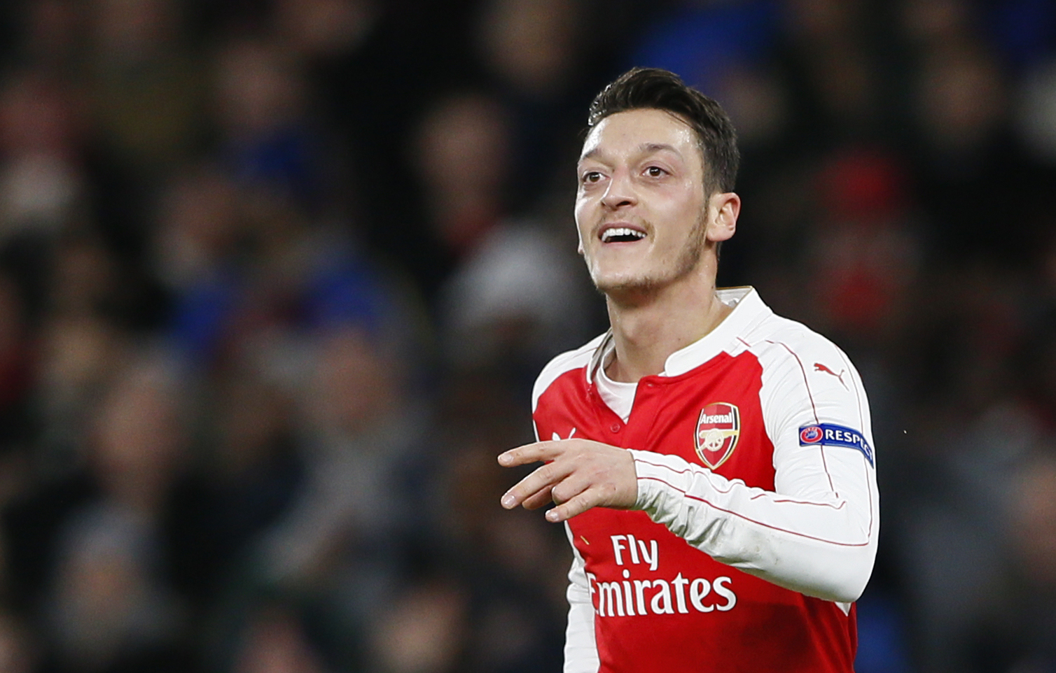 Mesut Ozil celebrates after scoring the first goal for Arsenal against Dinamo Zagreb during UEFA Champions League game at Emirates Stadium on November 24, 2015. Photo: Reuters