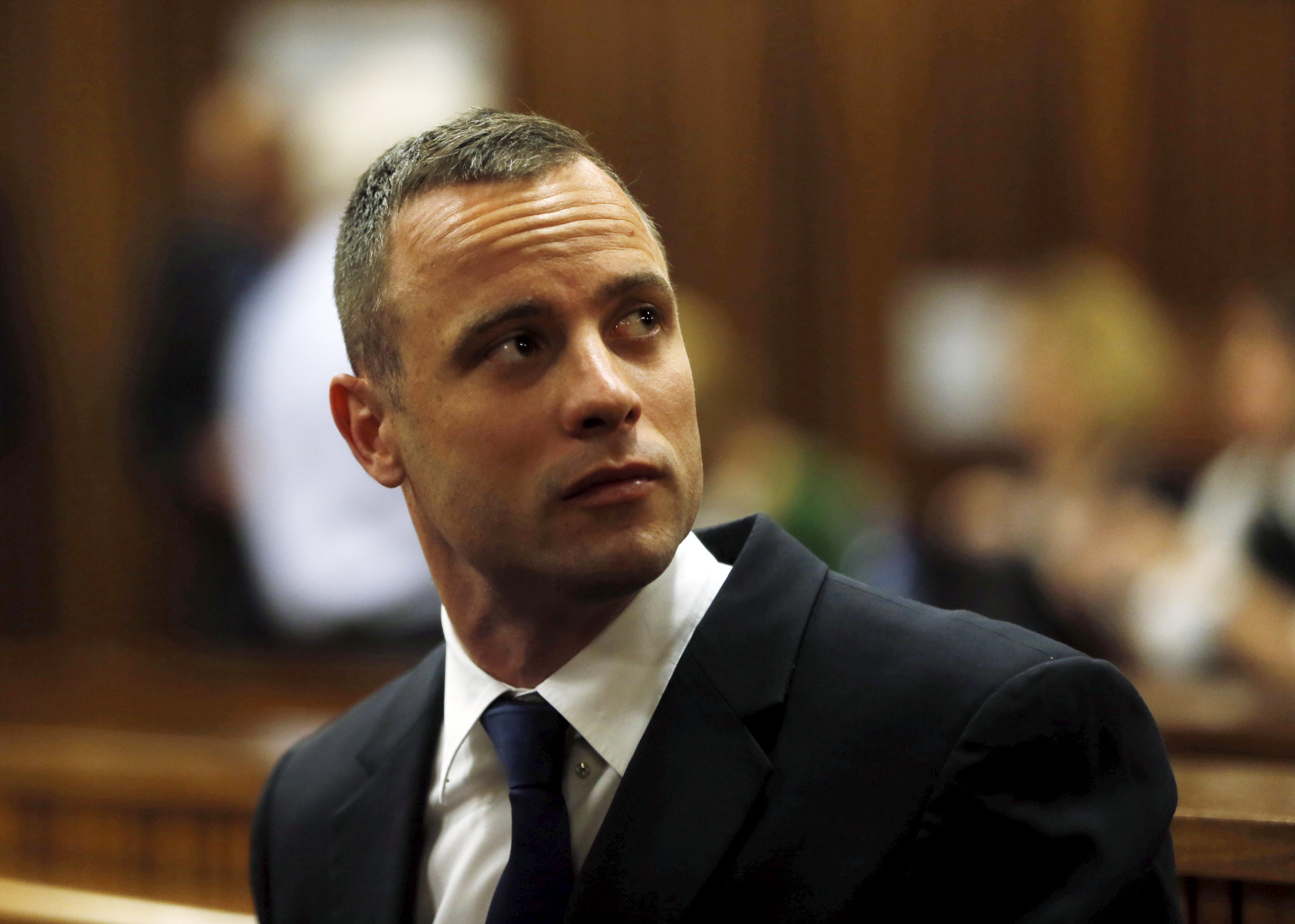 Olympic and Paralympic track star Oscar Pistorius sits in the dock in the North Gauteng High Court in Pretoria in this May 6, 2014 file photo. Courtesy: Reuters