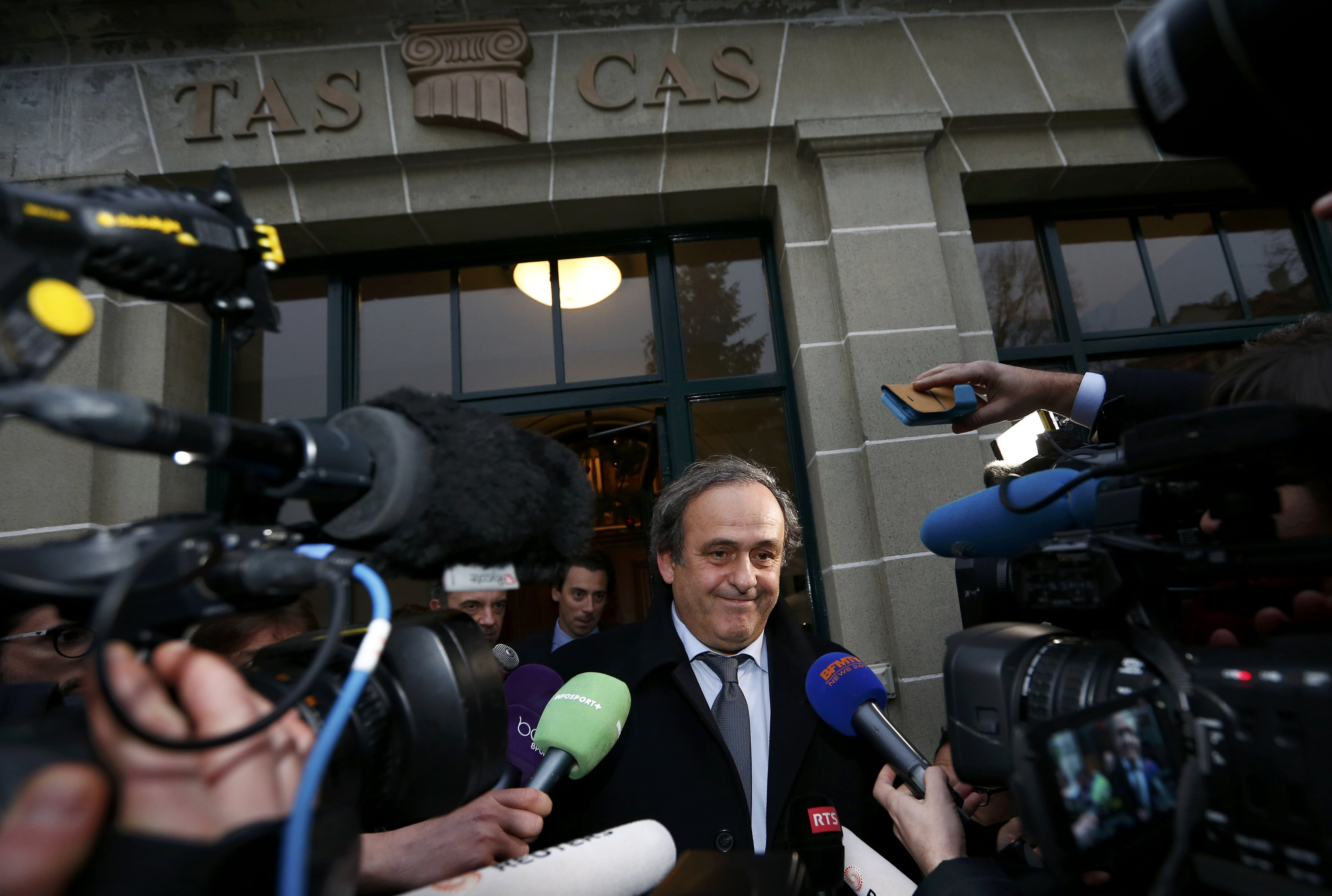 UEFA President Michel Platini leaves after a hearing at the Court of Arbitration for Sport (CAS) in Lausanne, Switzerland December 8, 2015. Photo: Reuters