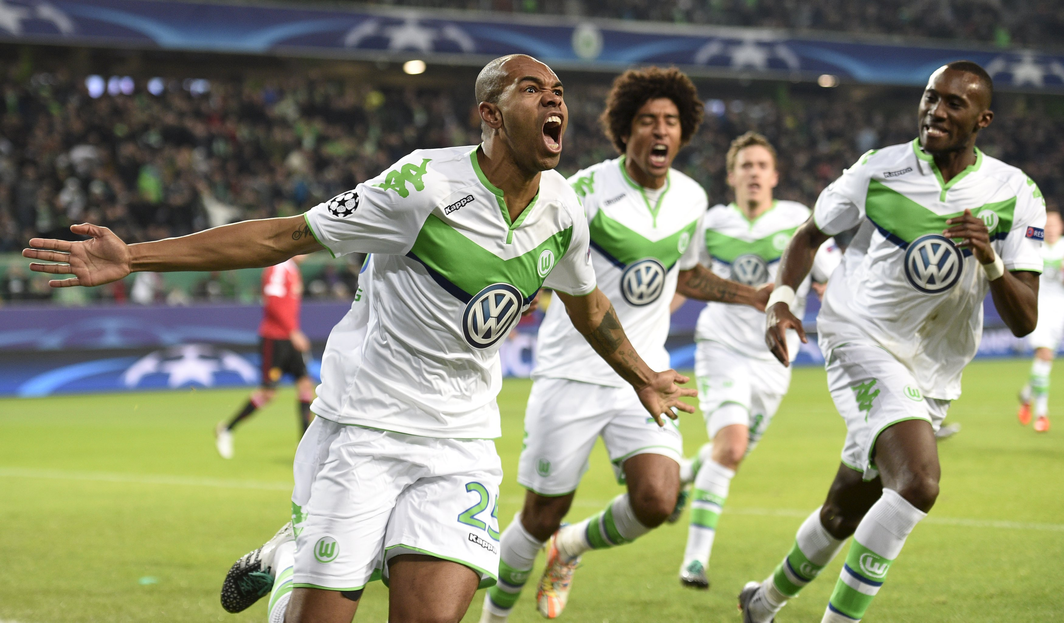 Naldo celebrates after scoring the first goal for Wolfsburg. Photo: Reuters