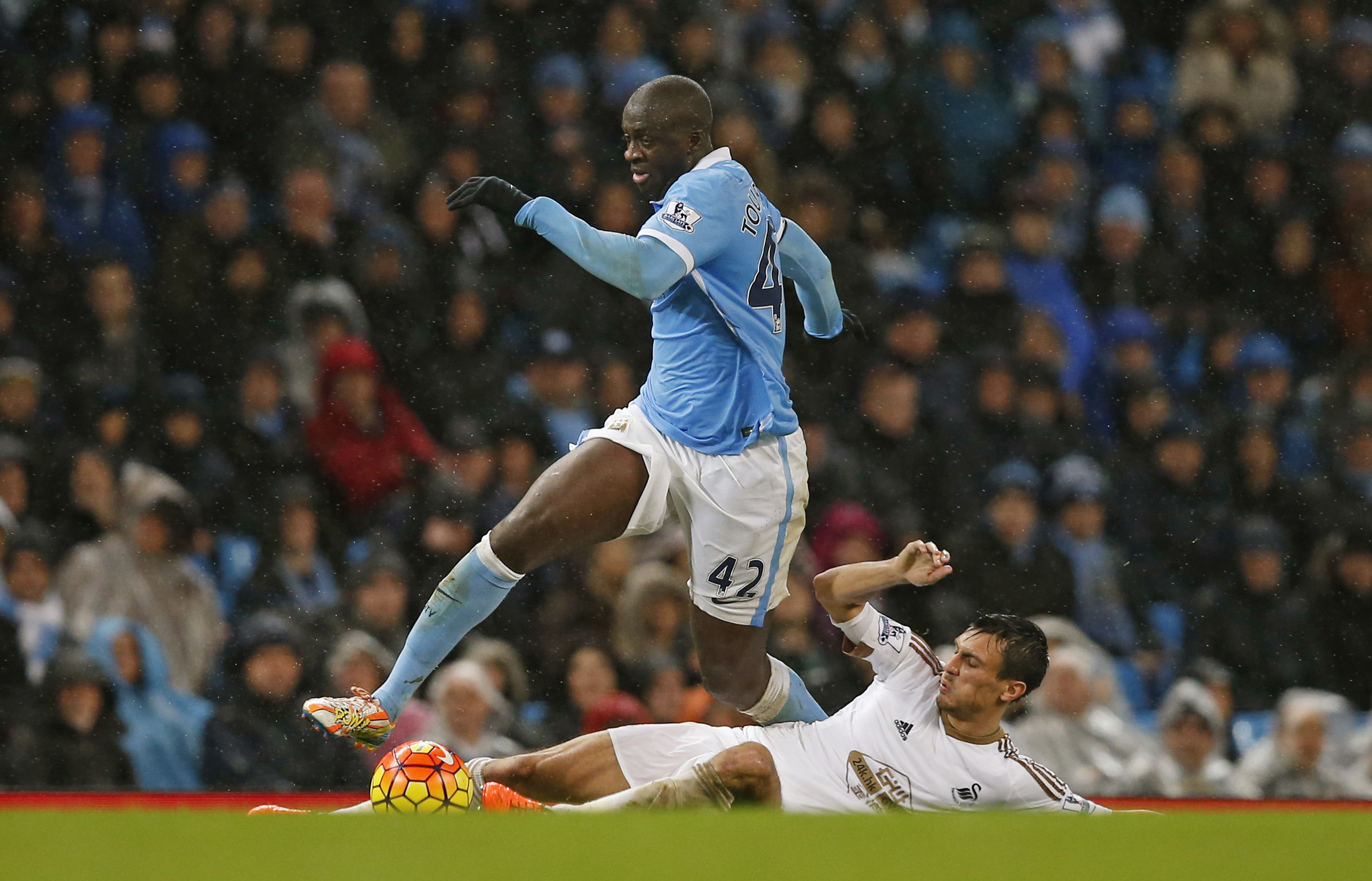 Manchester City's Yaya Toure in action with Swansea City's Jack Cork during Barclays Premier League game at Etihad Stadium on December 12, 2015. Photo: Reuters