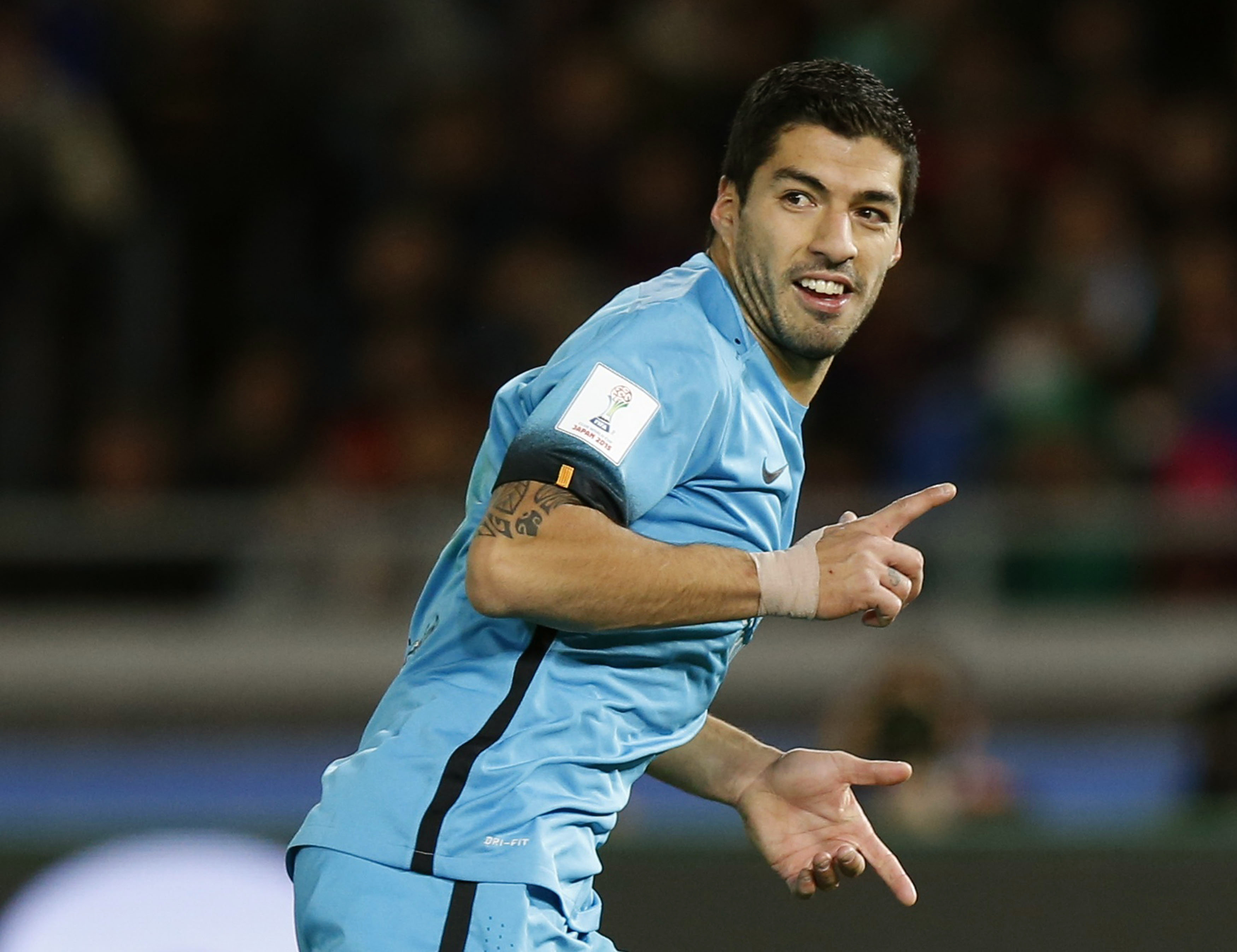 Barcelona's Luis Suarez celebrates after scoring against Guangzhou Evergrande during their Club World Cup semi-final soccer match in Yokohama, south of Tokyo, Japan, December 17, 2015. Photo: Reuters