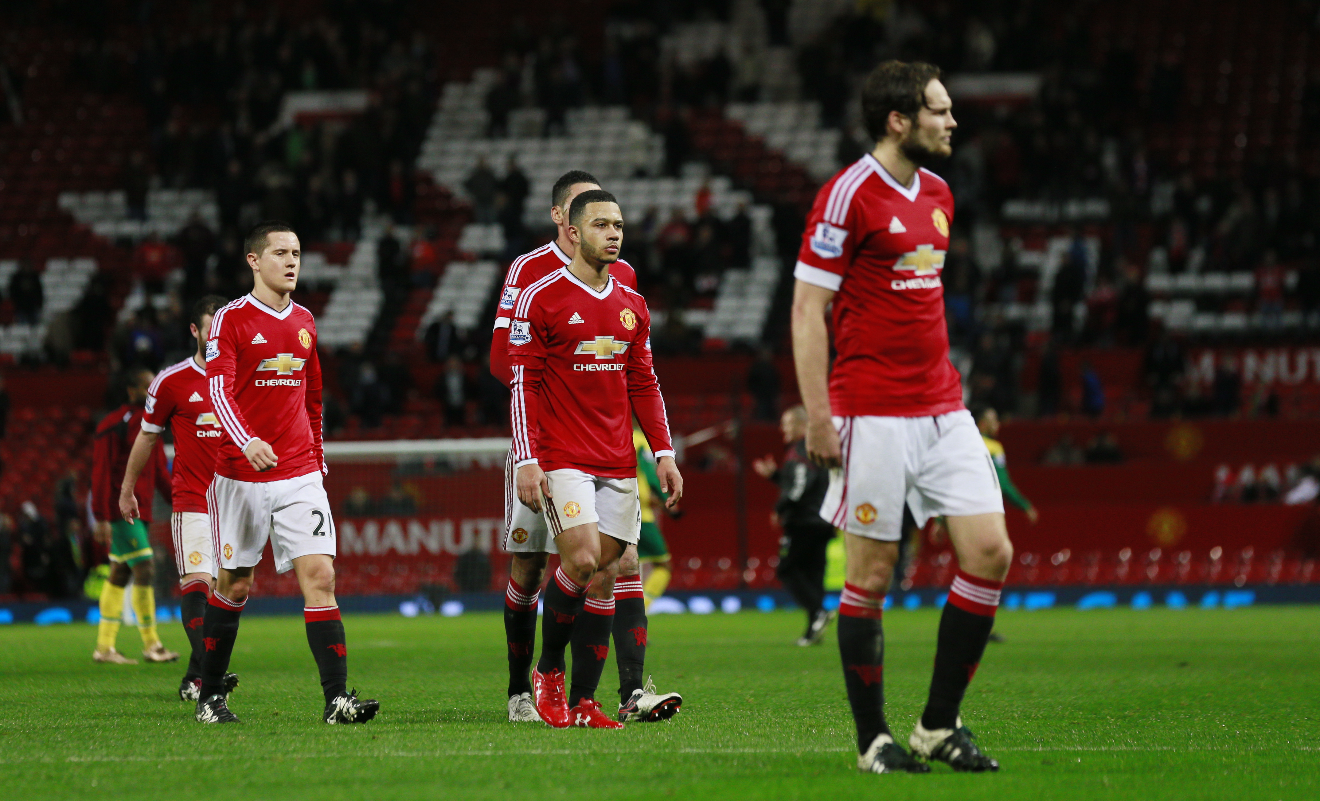 Manchester United players look dejected after the game in this undated file photo. Photo: Reuters