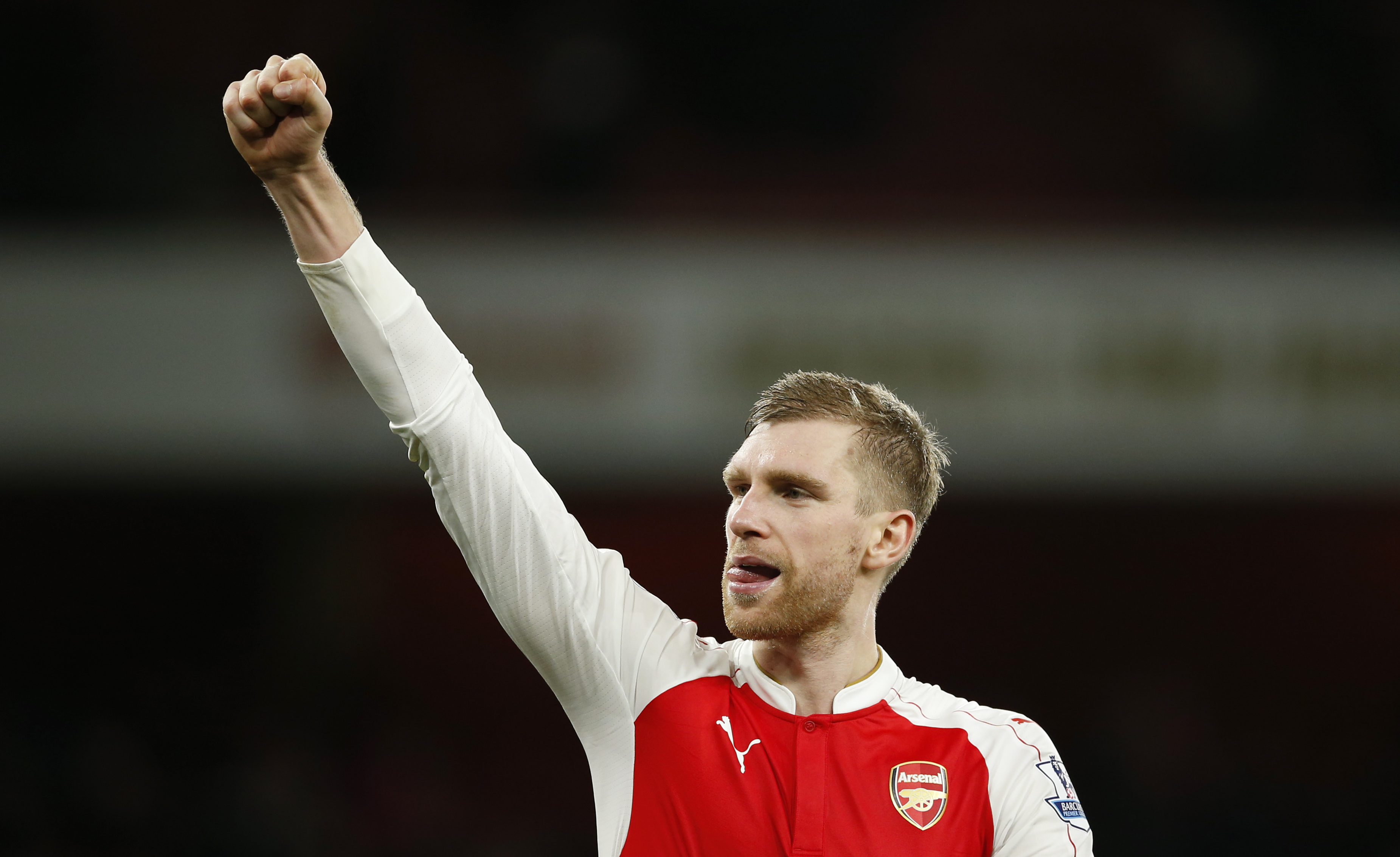 Arsenal's Per Mertesacker celebrates after the game against Manchester City at Emirates Stadium on Monday, December 21, 2015. Photo: Reuters