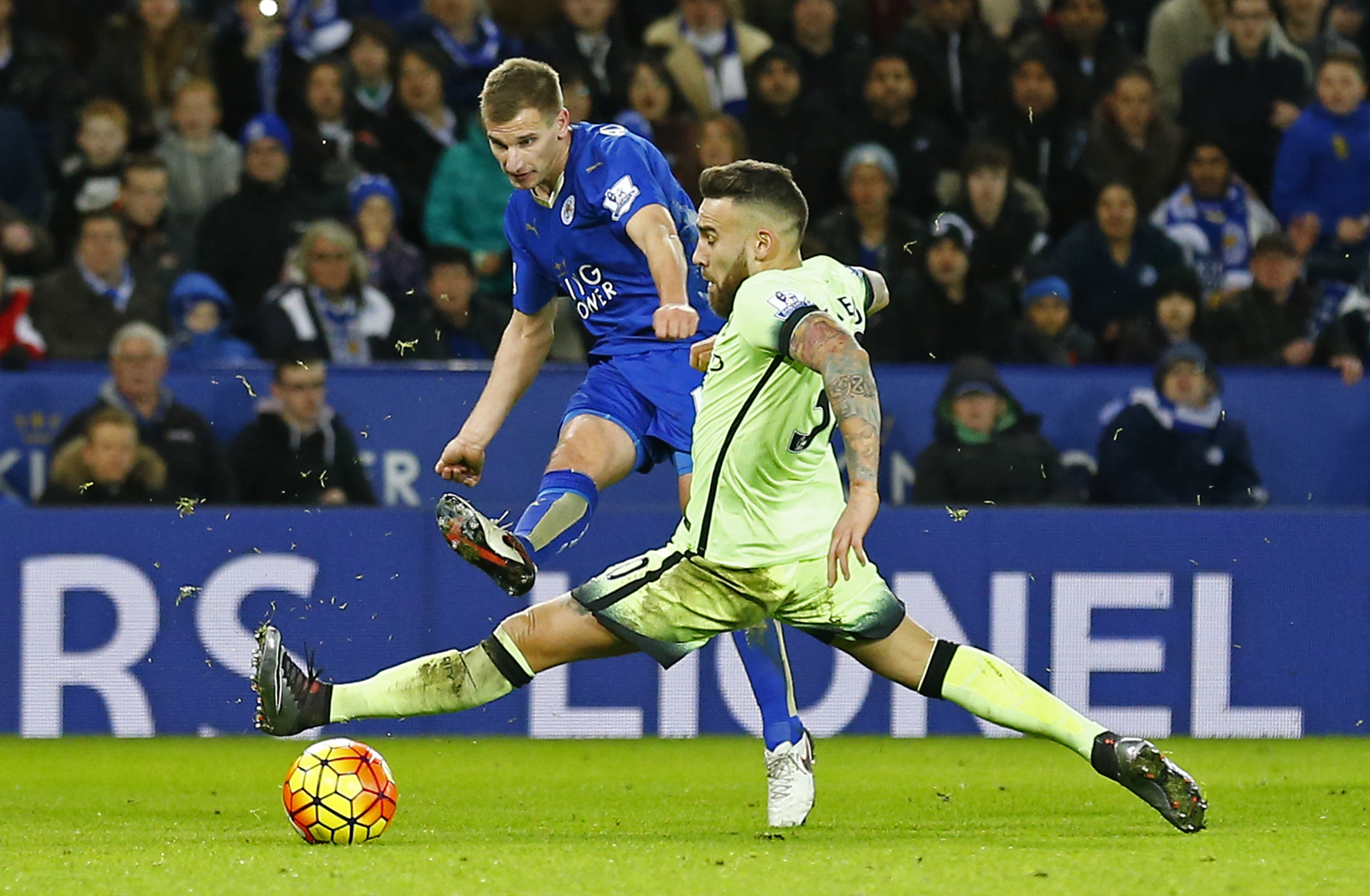 Leicester City's Marc Albrighton and Manchester City's Nicolas Otamendi in action at King Power Stadium on Tuesday, December 29, 2015. Photo: Reuters