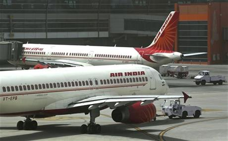 FILE - In this May 18, 2012, file photo, Air India planes are parked on the tarmac at the Terminal 3 of Indira Gandhi International Airport in New Delhi, India. Airport and airline authorities in India on Thursday, Dec. 17, 2015 began investigating the death of a technician who was sucked into an aircraft engine at an airport in Mumbai. Photo: AP