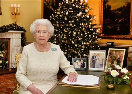 In this Dec. 10, 2015 photo, Britain's Queen Elizabeth II sits at a desk in the 18th Century Room in Buckingham Palace in London, after recording her Christmas Day broadcast to the Commonwealth, to be broadcast Friday, Dec. 25, 2015. Photo:AP