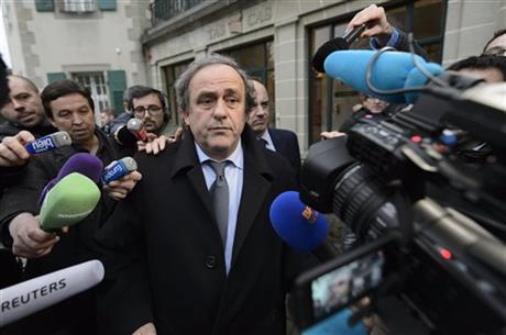 FILE - In this Dec. 8, 2015 file photo UEFA-President Michel Platini of France is surrounded by media after a hearing at the international Court of Arbitration for Sport, CAS, in Lausanne, Switzerland. Michel Platini lost his appeal Friday, Dec. 11, 2015 at the Court to Arbitration for Sport to lift a 90-day ban by FIFA. CAS said its three-man panel of judges was unanimous in ruling against the FIFA presidential hopeful. Photo: AP