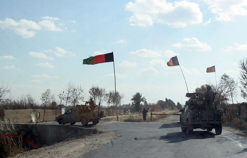 Afghan security forces patrol the Nad Ali district of Helmand province, Afghanistan on Tuesday, December 22, 2015. Photo: AP