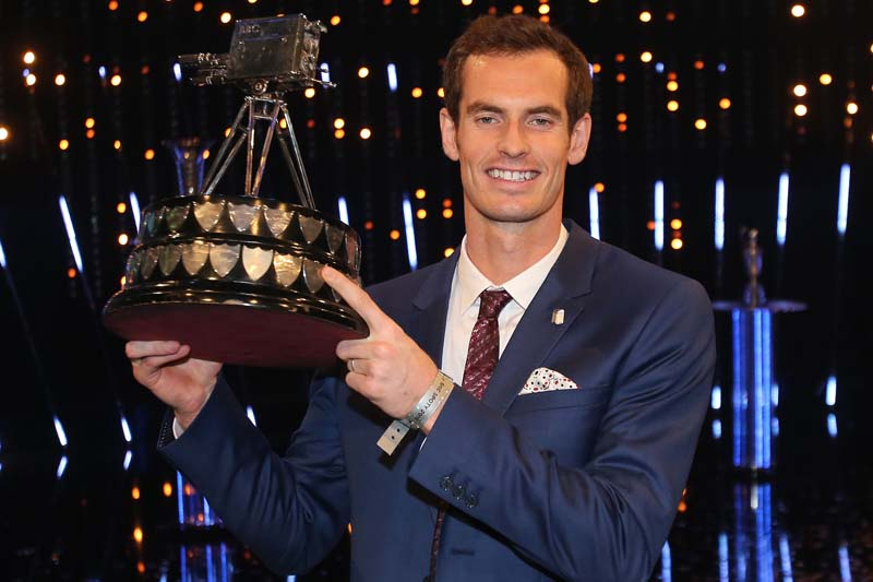 British tennis player Andy Murray poses with the trophy after winning the 2015 Sports Personality of the Year, in Belfast, Northern Ireland, on Sunday December 20, 2015. Photo: Niall Carson via AP