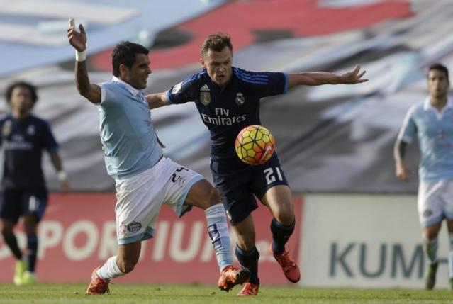 File photo of Celta Vigo's Augusto (L) fighting for the ball with Real Madrid's Denis Cheryshev during their Spanish first division soccer match at Balaidos stadium in Vigo, Spain October 24, 2015. REUTERS/Miguel Vidal
