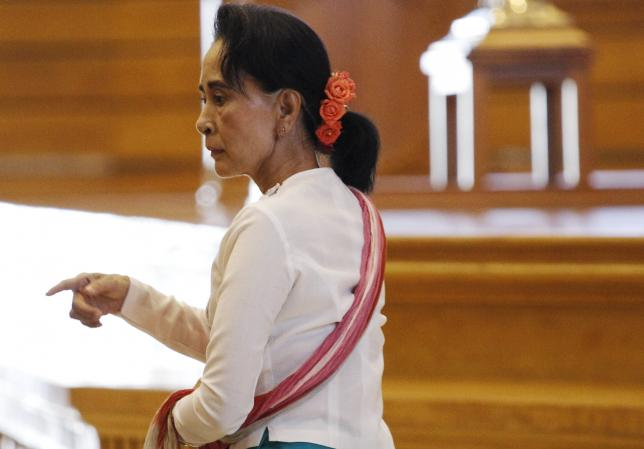 National League for Democracy (NLD) leader Aung San Suu Kyi arrives at a parliament meeting room after meeting with Shwe Mann (not pictured), speaker of Myanmar's Union Parliament, at the Lower House of Parliament in Naypyitaw November 19, 2015. REUTERS/Soe Zeya Tun