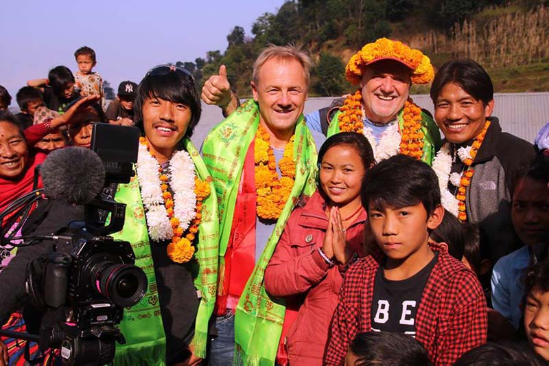 Austrian mountaineer and earthquake survivor Josef Einwaller visits quake survivors in Kakani village with his fellows Stephan Keck and Christina Hirbers in Nuwakot on Thursday, December 17, 2015. Photo: RSS