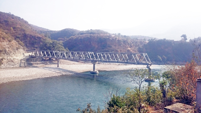 The bridge over Bheri River along the Chhinchu-Jajarkot road section is yet to be completed, on Thursday, December 24, 2015. Photo: THT