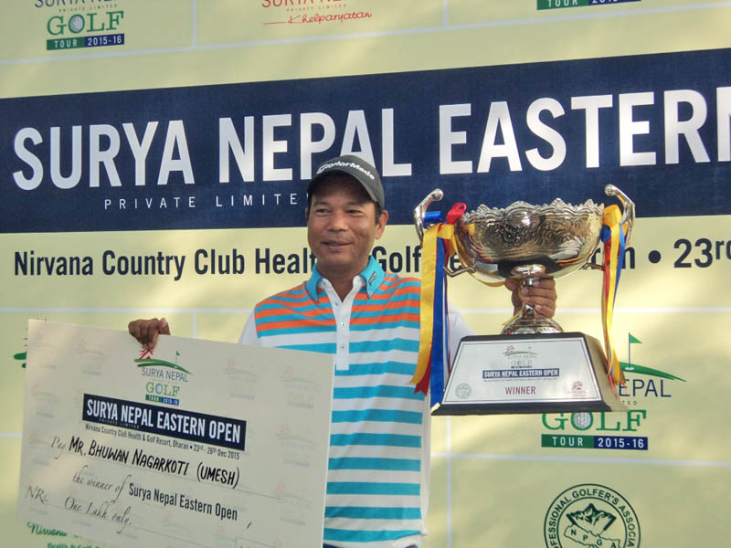 Bhuwan Nagarkoti of Gokarna Golf Club holds the trophy and cheque after winning the Surya Nepal Eastern Open at the Nirvana Country Club in Dharan on Friday. Phoyto: Courtesy Nepal PGA