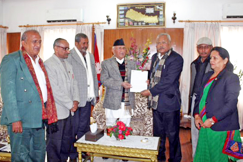 Bijay Kumar Gachhadar chairperson of Madhesi Janadhikar Forum-Democratic  drew attention about its agreement while forming government to Prime Minister KP Sharma Oli on Tuesday, December 15, 2015. Photo: RSS