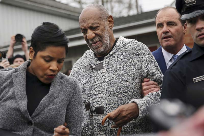 Actor and comedian Bill Cosby is helped as he leaves a court appearance where he faced a felony charge of aggravated indecent assault, in Elkins Park, Pennsylvania, on Wednesday, December 30, 2015. Photo: AP
