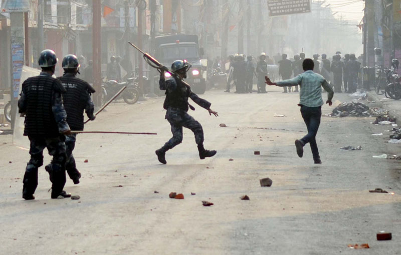 A policeman chases a protester at Birgunj of Parsa district on Saturday, December 19, 2015. Photo: Ram Sarraf