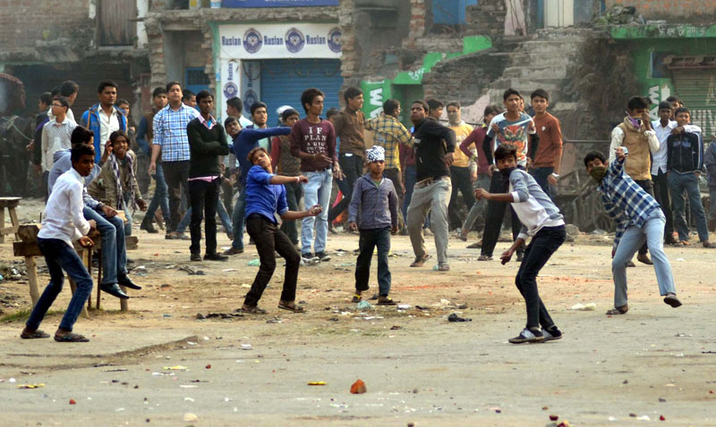 Protesters hurling stones at Nepal Police personnel at Birgunj of Parsa district on Saturday, December 19, 2015. Photo: Ram Sarraf