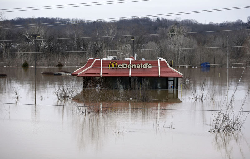 Floodwater from the Bourbeuse River surrounds a McDonald's restaurant on Tuesday, December 29, 2015, in Union, Mo. Photo: AP