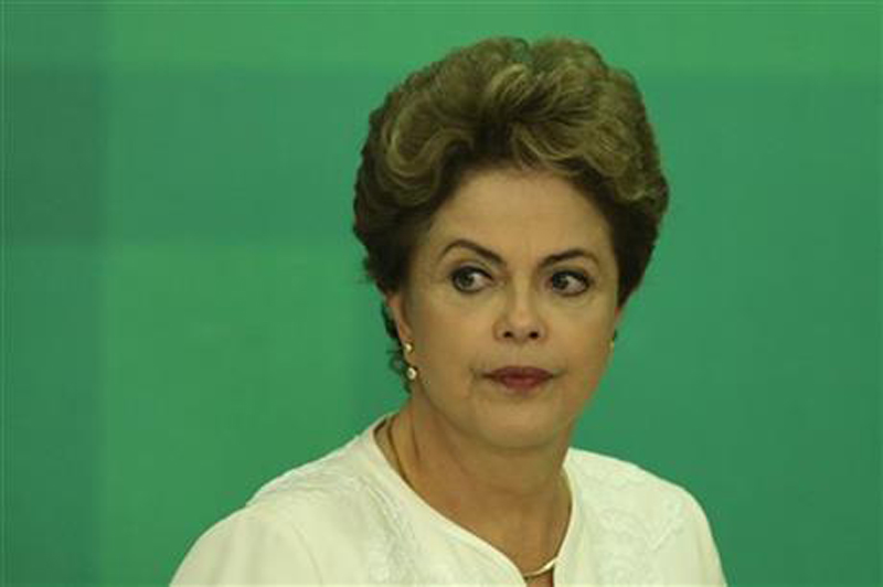 Brazil's President Dilma Rousseff arrives at a press conference after impeachment proceedings were opened against her by the President of Chamber of Deputies Eduardo Cunha, at the Planalto Presidential Palace in Brasilia, Brazil, Wednesday, Dec. 2, 2015. Photo: AP