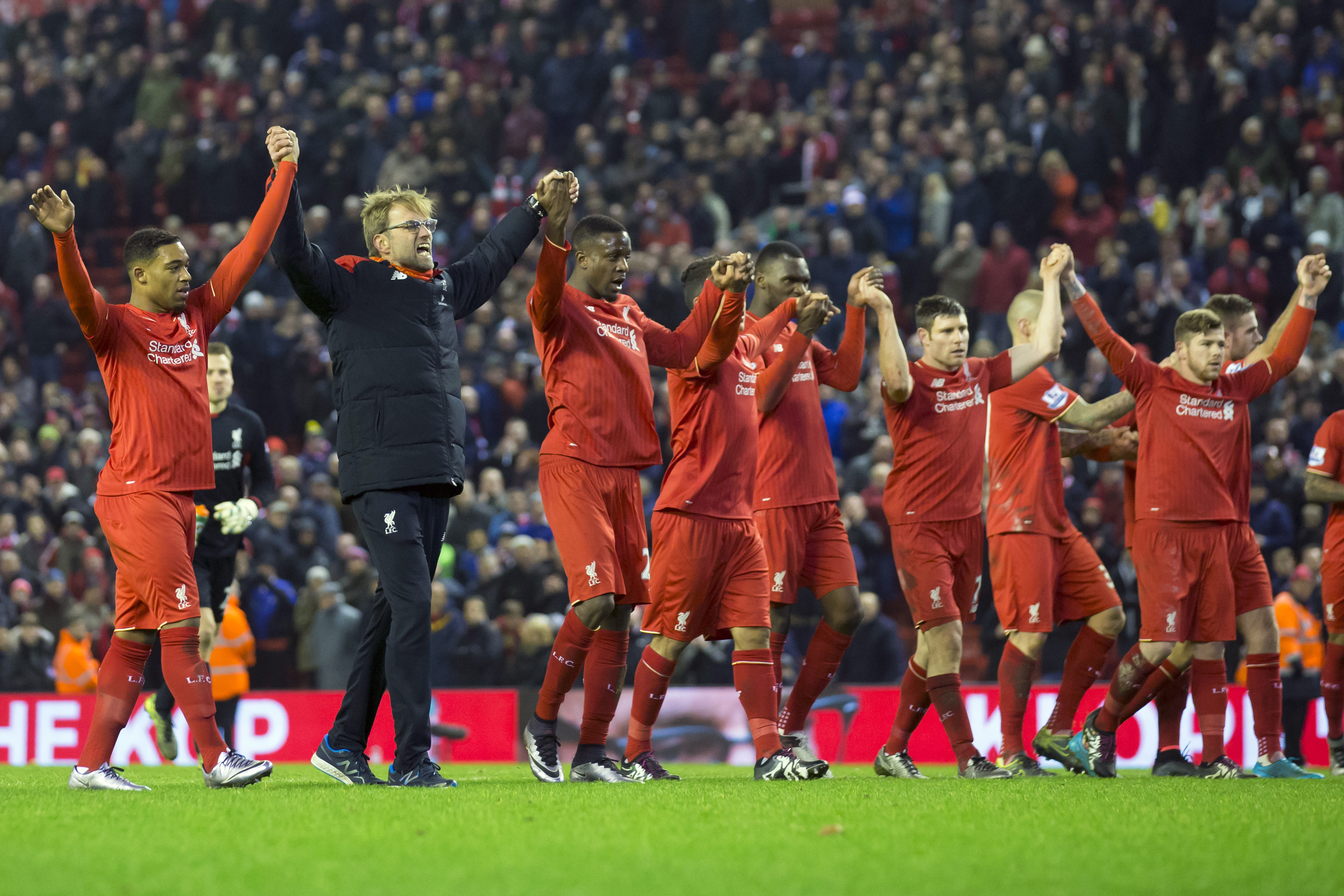 Liverpool's manager Juergen Klopp, second left, celebrates with his players after their 2-2 draw against West Bromwich Albion during the English Premier League soccer match between Liverpool and West Bromwich Albion at Anfield Stadium, Liverpool, England, Sunday, Dec. 13, 2015. Photo: AP