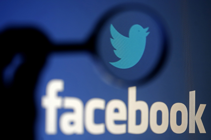 A logo of Twitter is pictured next to the logo of Facebook in this September 23, 2014 illustration photo in Sarajevo. Photo: Reuters