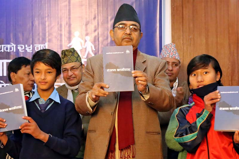 Deputy Prime Minister and Minister for Women, Children and Social Welfare CP Mainali launches the book 'Nepalma Bal Adhikar' amid a function in Kathmandu, on Tuesday, December 29, 2015. Photo: CWISH