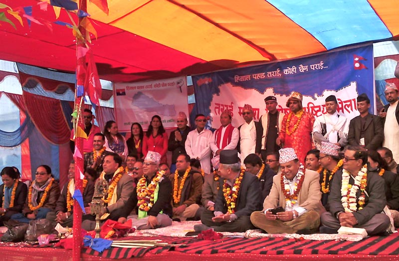 CPN-UML leaders Madhav Kumar Nepal (fifth from left in front) and Pradip Gyawali attending an inauguration of a two-month long a civil awareness programme on Nepalu2019s new constitution here in Hariban of Sarlahi, on Tuesday, December 15, 2015. Photo: Prabhat Jha