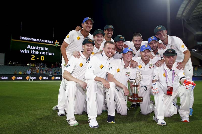 Australia's captain Steve Smith (centre) holds the Trans Tasman trophy as he celebrates with his team mates after they defeated New Zealand in the third cricket test match and the series at the Adelaide Oval, in South Australia, November 29, 2015. Photo: Reuters